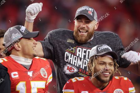 Kansas City Chiefs' Travis Kelce Patrick Mahomes and Tyrann Mathieu celebrate after the NFL AFC Championship football game against the Tennessee Titans, in Kansas City, MO. The Chiefs won 35-24 to advance to Super Bowl 54