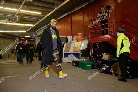 Kansas City Chiefs' Travis Kelce arrives before the NFL AFC Championship football game against the Tennessee Titans, in Kansas City, MO
