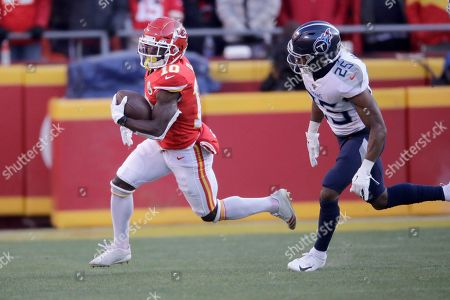 Kansas City Chiefs wide receiver Tyreek Hill (10) and Tennessee Titans cornerback Adoree' Jackson (25) during the first half of the NFL AFC Championship football game, in Kansas City, MO