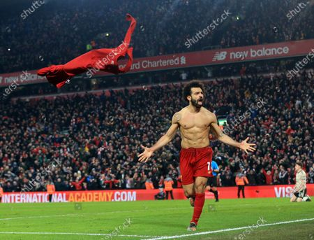 Stock Image of Mohamed Salah of Liverpool celebrates after scoring his team's second goal after 2 minutes of extra time