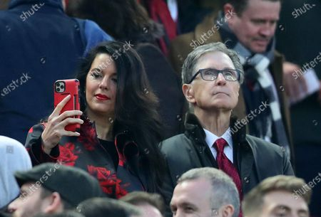 Stock Image of Liverpool owner John W Henry and his wife Linda Pizzuto look on from the directors' box