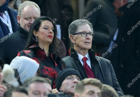 Liverpool owner John W Henry and his wife Linda Pizzuto look on from the directors' box