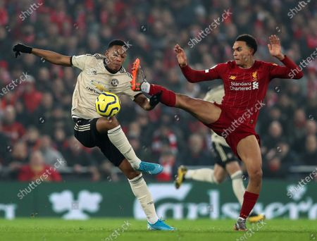 Anthony Martial of Manchester United computers for the ball with Trent Alexander-Arnold of Liverpool