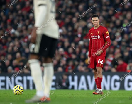 Trent Alexander-Arnold of Liverpool prepares to take a direct free kick at the Manchester United goal