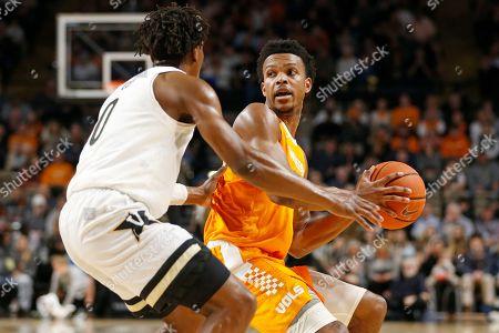 Tennessee guard Josiah-Jordan James, right, drives against Vanderbilt guard Saben Lee (0) in the first half of an NCAA college basketball game, in Nashville, Tenn