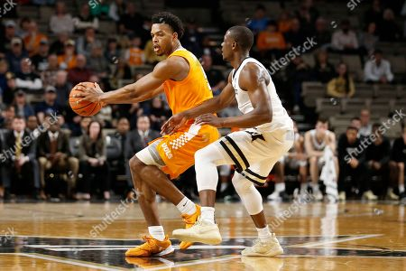 Tennessee guard Josiah-Jordan James, left, plays against Vanderbilt guard Maxwell Evans, right, in the second half of an NCAA college basketball game, in Nashville, Tenn. Tennessee won 66-45