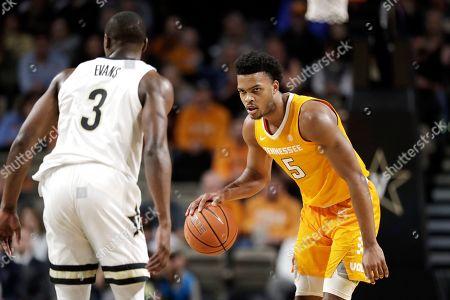 Tennessee guard Josiah-Jordan James (5) plays against Vanderbilt guard Maxwell Evans (3) in the first half of an NCAA college basketball game, in Nashville, Tenn