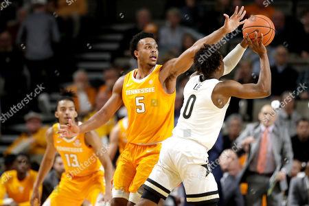 Tennessee guard Josiah-Jordan James (5) defends against Vanderbilt guard Saben Lee (0) in the first half of an NCAA college basketball game, in Nashville, Tenn