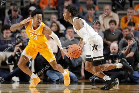 Vanderbilt guard Saben Lee, right, drives against Tennessee guard Jordan Bowden (23) in the first half of an NCAA college basketball game, in Nashville, Tenn