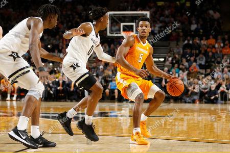 Tennessee guard Josiah-Jordan James (5) drives against Vanderbilt guard Saben Lee (0) in the first half of an NCAA college basketball game, in Nashville, Tenn