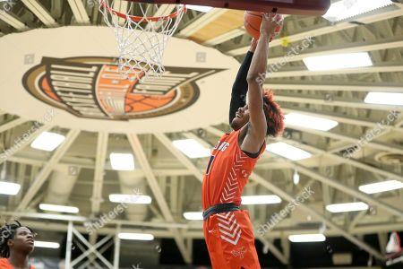 Whitney Young's Tyler Beard #0 dunks against Mount Vernon during a high school basketball game at the Hoophall Classic, in Springfield, MA