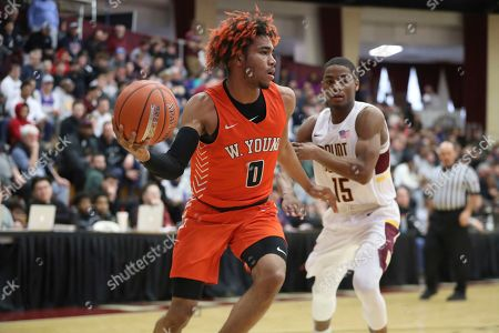Whitney Young's Tyler Beard #0 in action against Mount Vernon during a high school basketball game at the Hoophall Classic, in Springfield, MA