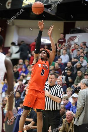 Whitney Young's Tyler Beard #0 takes a jumper against Mount Vernon during a high school basketball game at the Hoophall Classic, in Springfield, MA