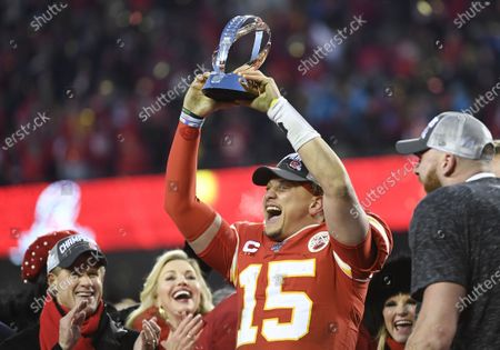 Kansas City Chiefs quarterback Patrick Mahomes hoists the Lamar Hunt trophy after winning the AFC Championship game at Arrowhead Stadium in Kansas City, Missouri, USA, 19 January 2020. Team owner Clark Hunt is at lower left, and tight end Travis Kelce is at right. The Chiefs will face either the Green Bay Packers or the San Francisco 49ers in Super Bowl LIV on 02 February 2020.