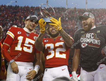 Kansas City Chiefs quarterback Patrick Mahomes (L) Tyrann Mathieu (C) and Travis Kelce (R) looks at the Lamar Hunt Trophy on stage after beating the Tennessee Titans in their AFC Championship game at Arrowhead Stadium in Kansas City, Missouri, USA, 19 January 2020. The winner will face either the Green Bay Packers or the San Francisco 49ers in Super Bowl LIV on 02 February 2020.