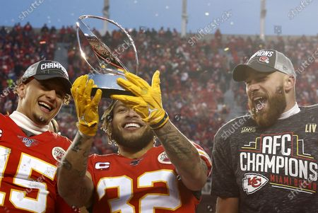 (L-R) Kansas City Chiefs Patrick Mahomes, Tyrann Mathieu and Travis Kelce celebrate with the Lamar Hunt Trophy after beating the Tennessee Titans in their AFC Championship game at Arrowhead Stadium in Kansas City, Missouri, USA, 19 January 2020. The winner will face either the Green Bay Packers or the San Francisco 49ers in Super Bowl LIV on 02 February 2020.