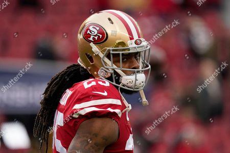 San Francisco 49ers cornerback Richard Sherman (25) warms up before the NFL NFC Championship football game against the Green Bay Packers, in Santa Clara, Calif