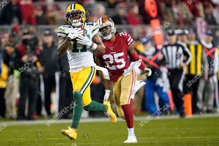 Green Bay Packers wide receiver Davante Adams (17) catches a pass in front of San Francisco 49ers cornerback Richard Sherman (25) during the second half of the NFL NFC Championship football game, in Santa Clara, Calif