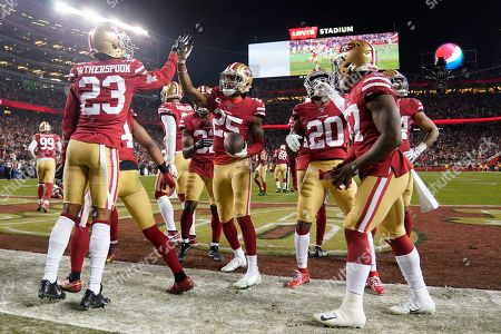 San Francisco 49ers players celebrate after cornerback Richard Sherman, center, intercepted a pass against the Green Bay Packers during the second half of the NFL NFC Championship football game, in Santa Clara, Calif. The 49ers won 37-20 to advance to Super Bowl 54 against the Kansas City Chiefs