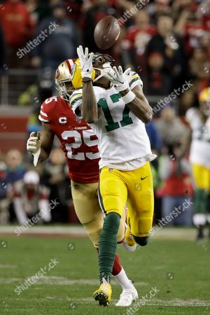 Green Bay Packers wide receiver Davante Adams catches a pass in front of San Francisco 49ers cornerback Richard Sherman during the second half of the NFL NFC Championship football game, in Santa Clara, Calif
