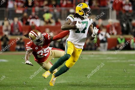 Green Bay Packers wide receiver Davante Adams breaks away form San Francisco 49ers cornerback Richard Sherman during the second half of the NFL NFC Championship football game, in Santa Clara, Calif