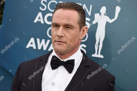 Andrey Ivchenko arrives at the 26th annual Screen Actors Guild Awards at the Shrine Auditorium & Expo Hall, in Los Angeles