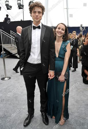 Stock Picture of Douglas Smith, Tricia Travis. Douglas Smith, left, and Tricia Travis arrive at the 26th annual Screen Actors Guild Awards at the Shrine Auditorium & Expo Hall, in Los Angeles
