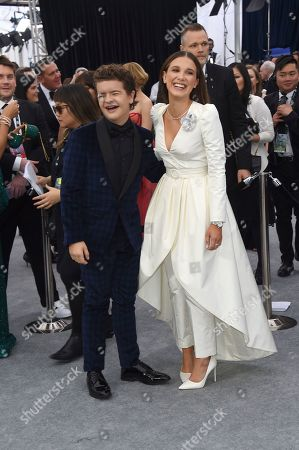 Millie Bobby Brown, Gaten Matarazzo. Gaten Matarazzo, left, and Millie Bobby Brown arrive at the 26th annual Screen Actors Guild Awards at the Shrine Auditorium & Expo Hall, in Los Angeles