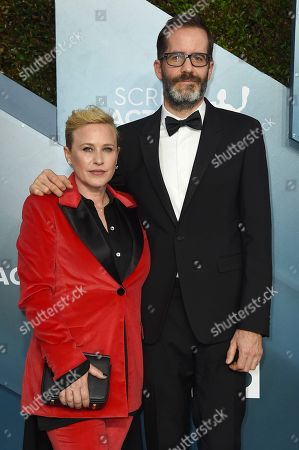 Stock Photo of Patricia Arquette, Eric White. Patricia Arquette, left, and Eric White arrive at the 26th annual Screen Actors Guild Awards at the Shrine Auditorium & Expo Hall, in Los Angeles