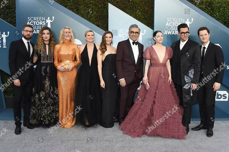 Stock Image of Dustin Milligan, Annie Murphy, Catherine O'Hara, Jennifer Robertson, Sarah Levy, Eugene Levy, Emily Hampshire, Dan Levy, Noah Reid. Dustin Milligan, from left, Annie Murphy, Catherine O'Hara, Jennifer Robertson, Sarah Levy, Eugene Levy, Emily Hampshire, Dan Levy, and Noah Reid arrive at the 26th annual Screen Actors Guild Awards at the Shrine Auditorium & Expo Hall, in Los Angeles