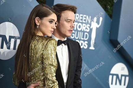 Stock Image of Natalia Dyer, Charlie Heaton. Natalia Dyer, left, and Charlie Heaton arrive at the 26th annual Screen Actors Guild Awards at the Shrine Auditorium & Expo Hall, in Los Angeles