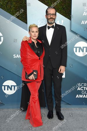 Patricia Arquette, Eric White. Patricia Arquette, left, and Eric White arrive at the 26th annual Screen Actors Guild Awards at the Shrine Auditorium & Expo Hall, in Los Angeles
