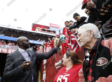 San Francisco 49ers Hall of Famer Jerry Rice signs autographs on the field before the San Francisco 49ers play the Green Bay Packers in the NFC Championship game at Levi's Stadium in Santa Clara, California, USA, 19 January 2020. The winner will face either the Kansas City Chiefs or the Tennessee Titans in Super Bowl LIV on 02 February 2020.