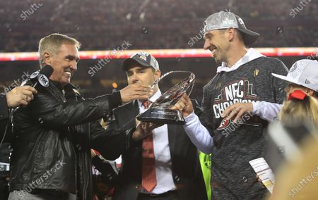 Former NFL head coach Mike Shanahan (L) hands 49ers head coach and his son Kyle Shanahan the George Halas trophy after the San Francisco 49ers defeated the Packers in their NFC Championship game at Levi's Stadium in Santa Clara, California, USA, 19 January 2020. The 49ers will face the Kansas City Chiefs in Super Bowl LIV on 02 February 2020.