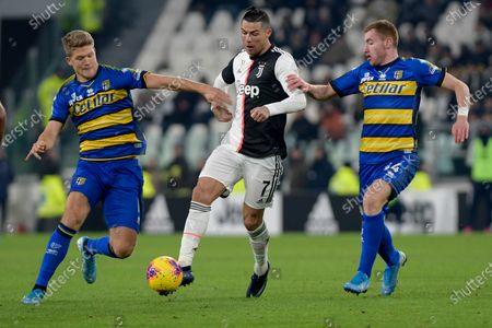 Stock Picture of Cristiano Ronaldo of Juventus breaks between Andreas Cornelius and Dejan Kulusevski of Parma