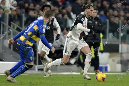 Adrien Rabiot of Juventus breaks past Parma defenders on the ball
