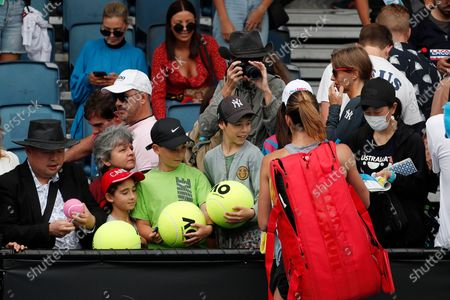 Petra Martic of Croatia signs autographs for fans after winning her women's singles first round match against Christina McHale of USA at the Australian Open Grand Slam tennis tournament in Melbourne, Australia, 20 January 2020.