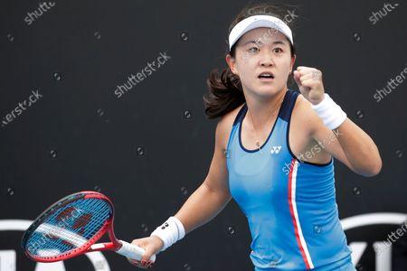 Zhu Lin of China celebrates winning her women's singles first round match against Viktorija Golubic of Switzerland at the Australian Open Grand Slam tennis tournament in Melbourne, Australia, 20 January 2020.