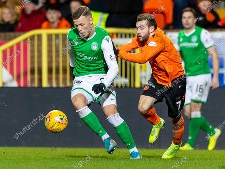 Flo Kamberi of Hibernian holds off Paul McMullan of Dundee United