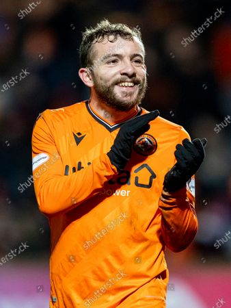 Paul McMullan of Dundee United applauds the fans after the game