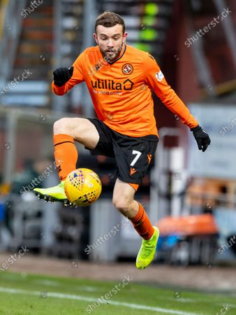 Paul McMullan of Dundee United controls the high ball