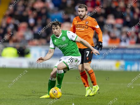 Paul McMullan of Dundee United held off by Lewis Stevenson of Hibernian