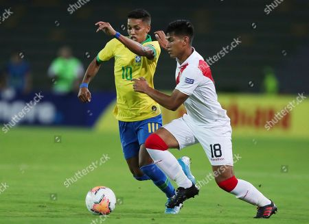 Pedrinho, Jose Rivera. Brazil's Pedrinho, left, fights for the ball with Peru's Jose Rivera during a South America Olympic qualifying U23 soccer match at the Centenario stadium in Armenia, Colombia