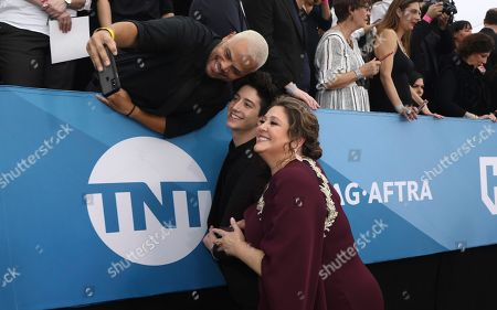 Milo Manheim, Camryn Manheim. Milo Manheim, left, and Camryn Manheim take a photo with a fan as they arrive at the 26th annual Screen Actors Guild Awards at the Shrine Auditorium & Expo Hall, in Los Angeles