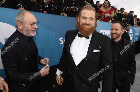 Stock Image of Liam Cunningham, Kristofer Hivju, Ben Crompton. Liam Cunningham, from left, Kristofer Hivju and Ben Crompton arrive at the 26th annual Screen Actors Guild Awards at the Shrine Auditorium & Expo Hall, in Los Angeles