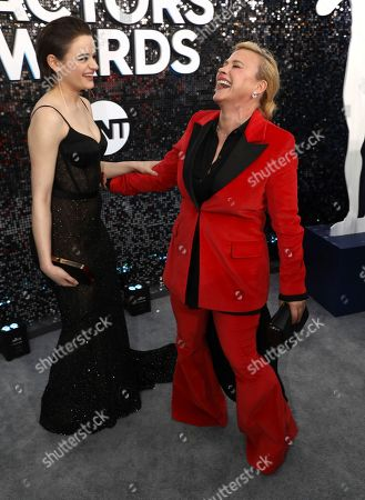 Joey King, Patricia Arquette. Joey King, left, and Patricia Arquette arrive at the 26th annual Screen Actors Guild Awards at the Shrine Auditorium & Expo Hall, in Los Angeles