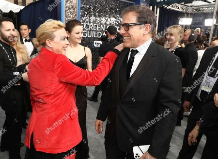 Stock Image of Patricia Arquette, David O. Russell. Patricia Arquette, left, and David O. Russell arrive at the 26th annual Screen Actors Guild Awards at the Shrine Auditorium & Expo Hall, in Los Angeles