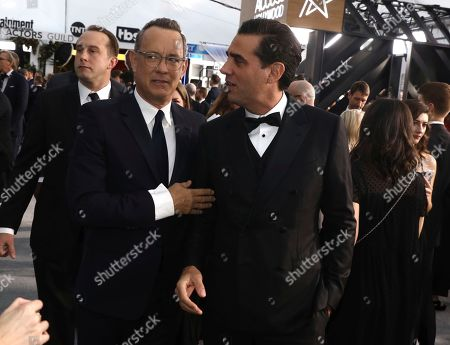 Tom Hanks, Bobby Cannavale. Tom Hanks, left, and Bobby Cannavale arrive at the 26th annual Screen Actors Guild Awards at the Shrine Auditorium & Expo Hall, in Los Angeles