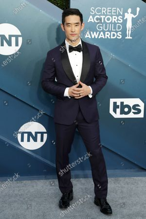 Stock Image of Mike Moh arrives for the 26th annual Screen Actors Guild Awards ceremony at the Shrine Auditorium in Los Angeles, California, USA, 19 January 2020.