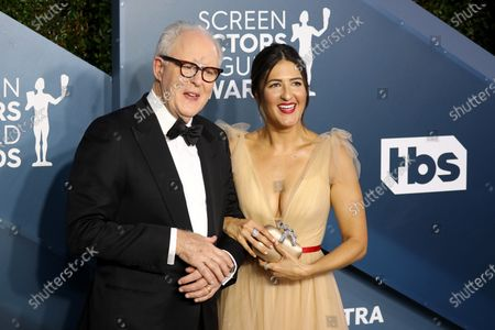 Stock Photo of John Lithgow and D'Arcy Carden arrive for the 26th annual Screen Actors Guild Awards ceremony at the Shrine Auditorium in Los Angeles, California, USA, 19 January 2020.